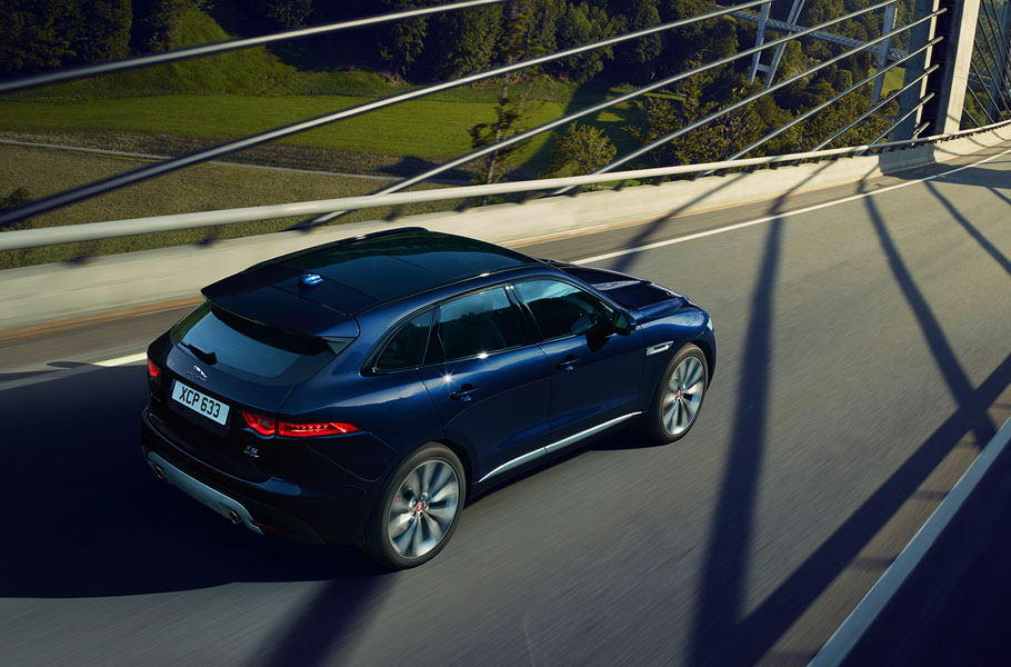 Jaguar F-PACE S driving across bridge