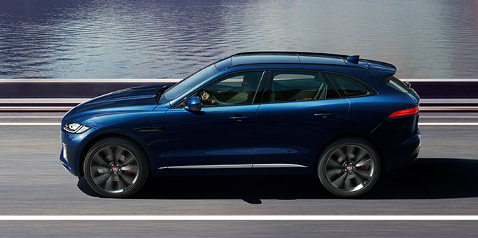 Side Profile of Jaguar F-PACE S driving on road