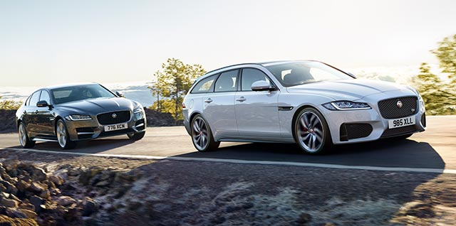 Grey Jaguar XF and White XF Sportbrake driving on road