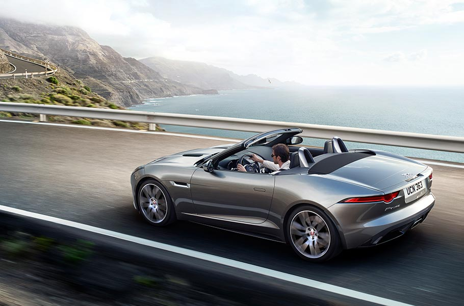 Silver Grey F TYPE Convertible driving on Mountain Road