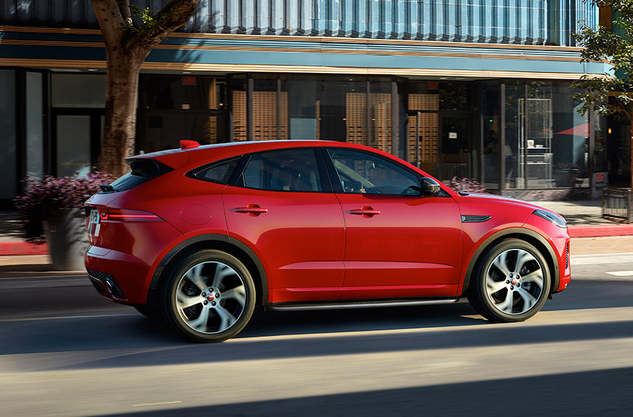 Jaguar E-PACE Red First Edition driving on Street Road