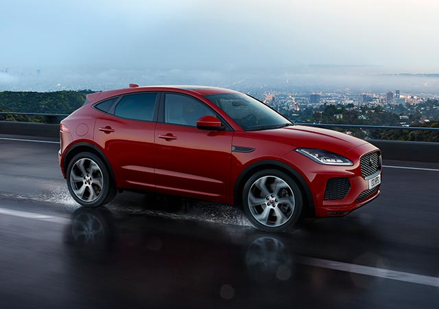 Jaguar Red E PACE driving on wet road