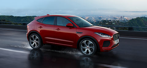 Jaguar New E PACE driving across road