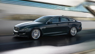Jaguar XJ in black driving on road