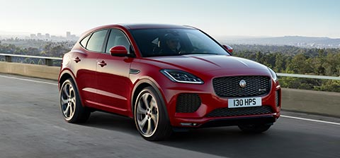 E PACE First Edition in Red driving on road