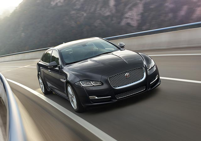 Carpathian Grey Jaguar XJ driving on road