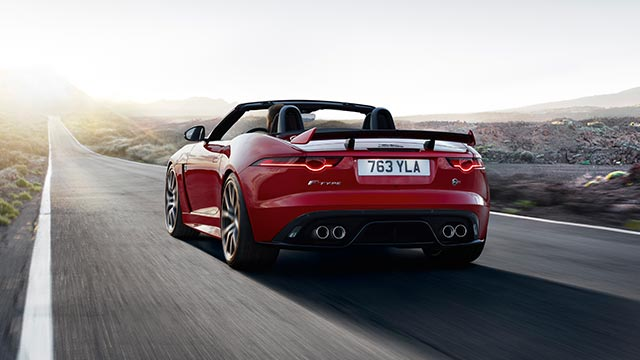 Jaguar Power: F-TYPE Coupé Sports Car drives along an open road