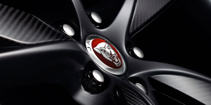 The badging on the wheel of a Jaguar F-TYPE