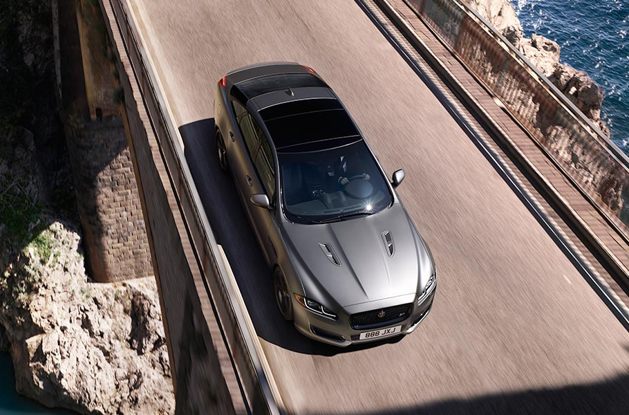 Overhead View of Jaguar XJR575 Driving on Road