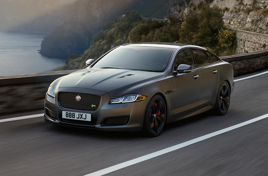 Jaguar XJR575 Driving on Road