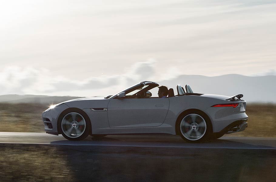 Jaguar F-TYPE R Convertible drives along a road