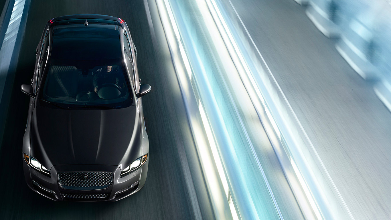 The XJ features standard LED headlights with Adaptive Lighting and Intelligent High Beams.
