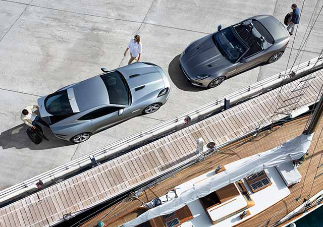 Grey F TYPE Convertible and Coupe parked on docks by the sea