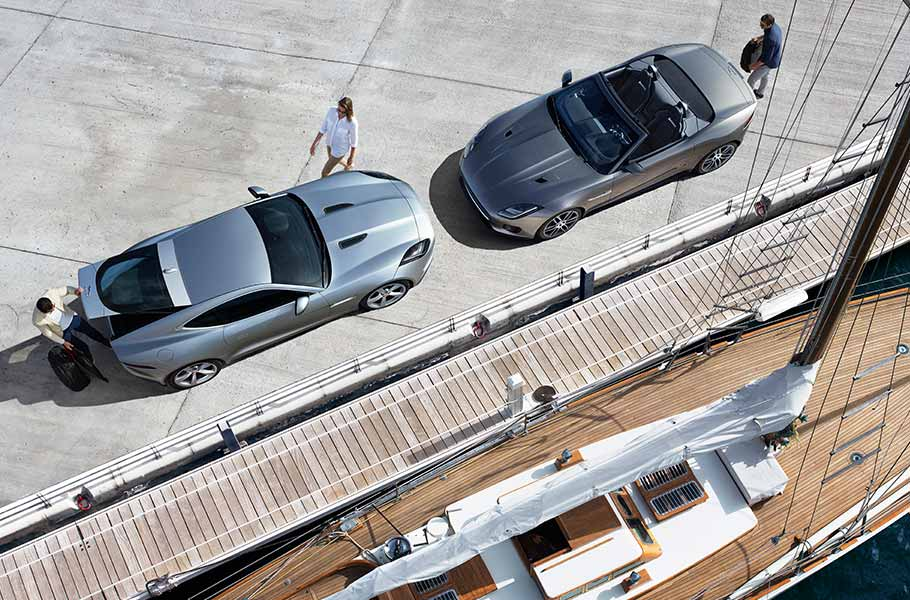 Grey Jaguar F TYPE Coupe Convertible parked by docks