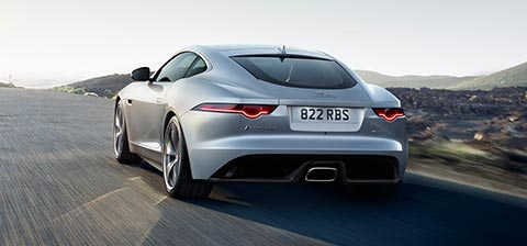 Grey F TYPE Jaguar driving on road