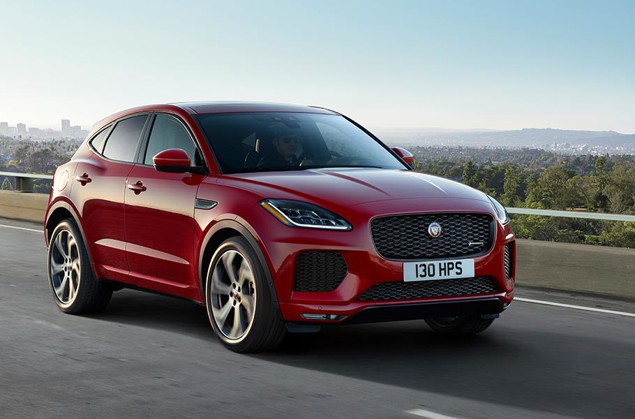 E PACE red Jaguar new driving on road
