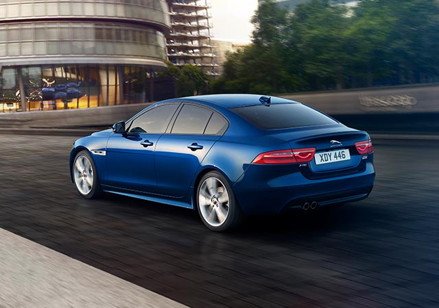 Jaguar Blue XE driving in London Streets