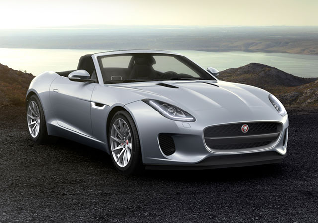 Jaguar F-TYPE Convertible sports car parked on a gravelly surface