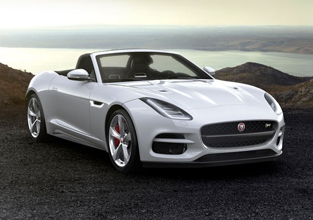 Jaguar F-TYPE R Convertible Sports Car parked on a gravelly surface