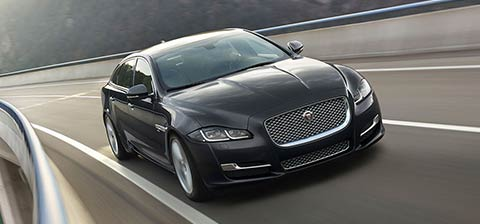 Jaguar XJ Driving on Road
