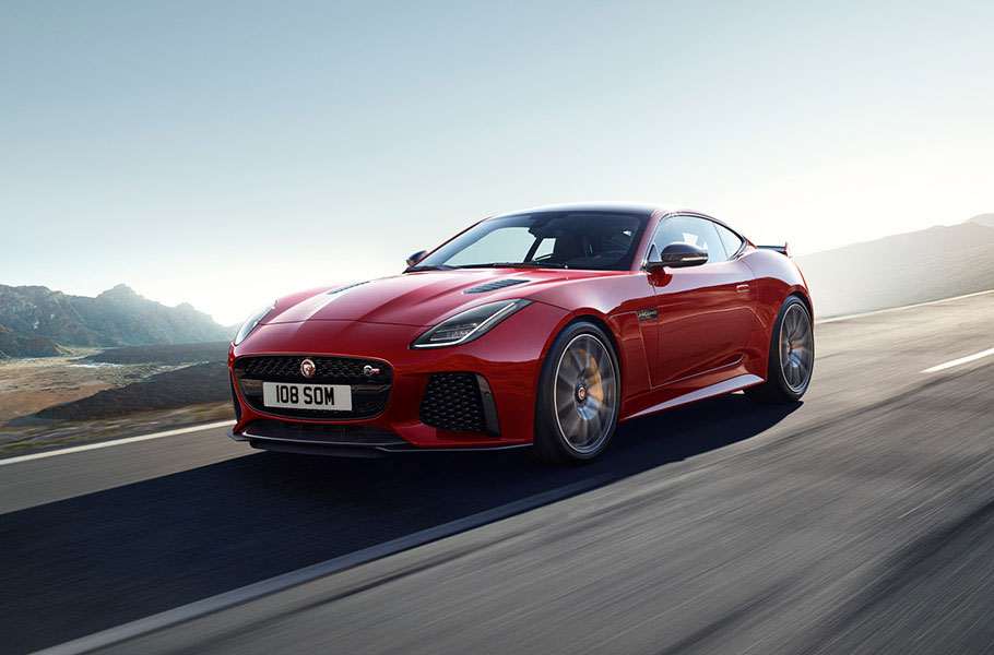 Red Jaguar F-TYPE Coupe driving on road