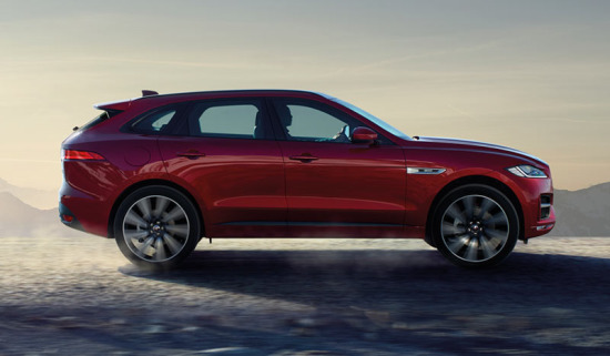 Jaguar F-PACE driving along a road