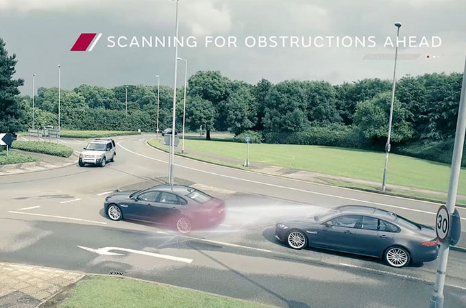 Jaguar Autonomous Vehicle Driving On Road Scanning For Obstructions.