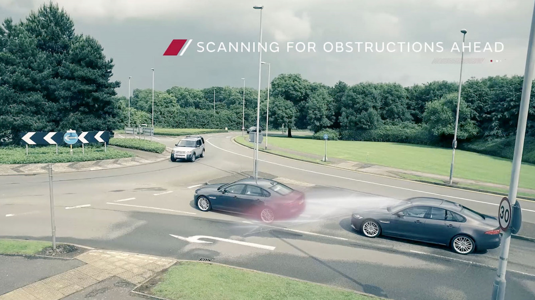 Jaguar Autonomous Vehicle On A Road Scanning For Obstacles