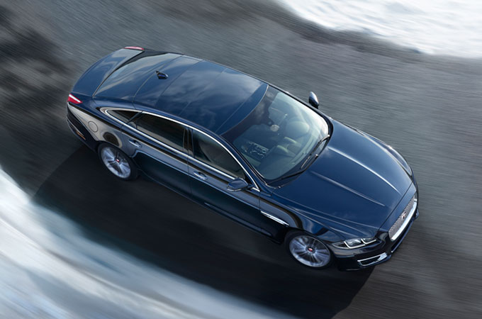 Jaguar XJ Driving on Icy Road.