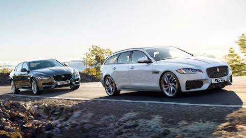 White Jaguar XF Sportbrake and Grey XF Saloon driving on road