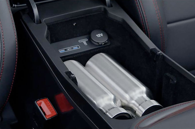 Jaguar E-Pace centre console storage space with water bottles inside.