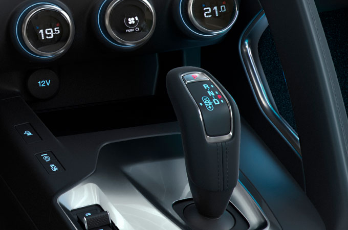 Close up of Jaguar E-Pace's gear stick, demonstrating configurable ambient lighting.