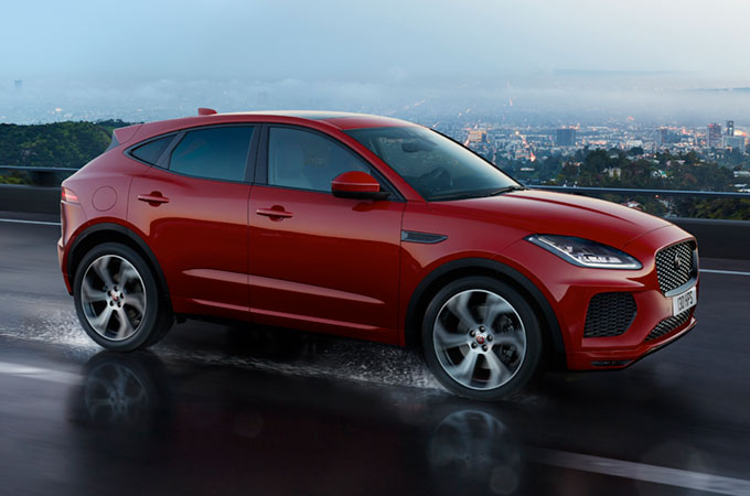 Jaguar E-Pace driving along a wet road.