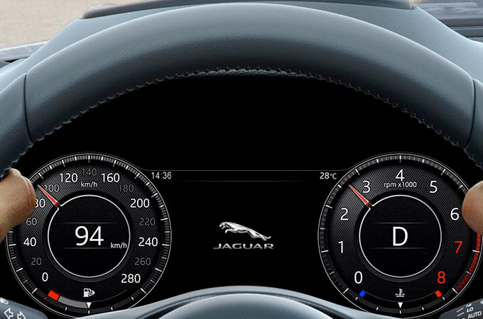 Jaguar E-Pace close up of Interactive Driver Displays through steering wheel.