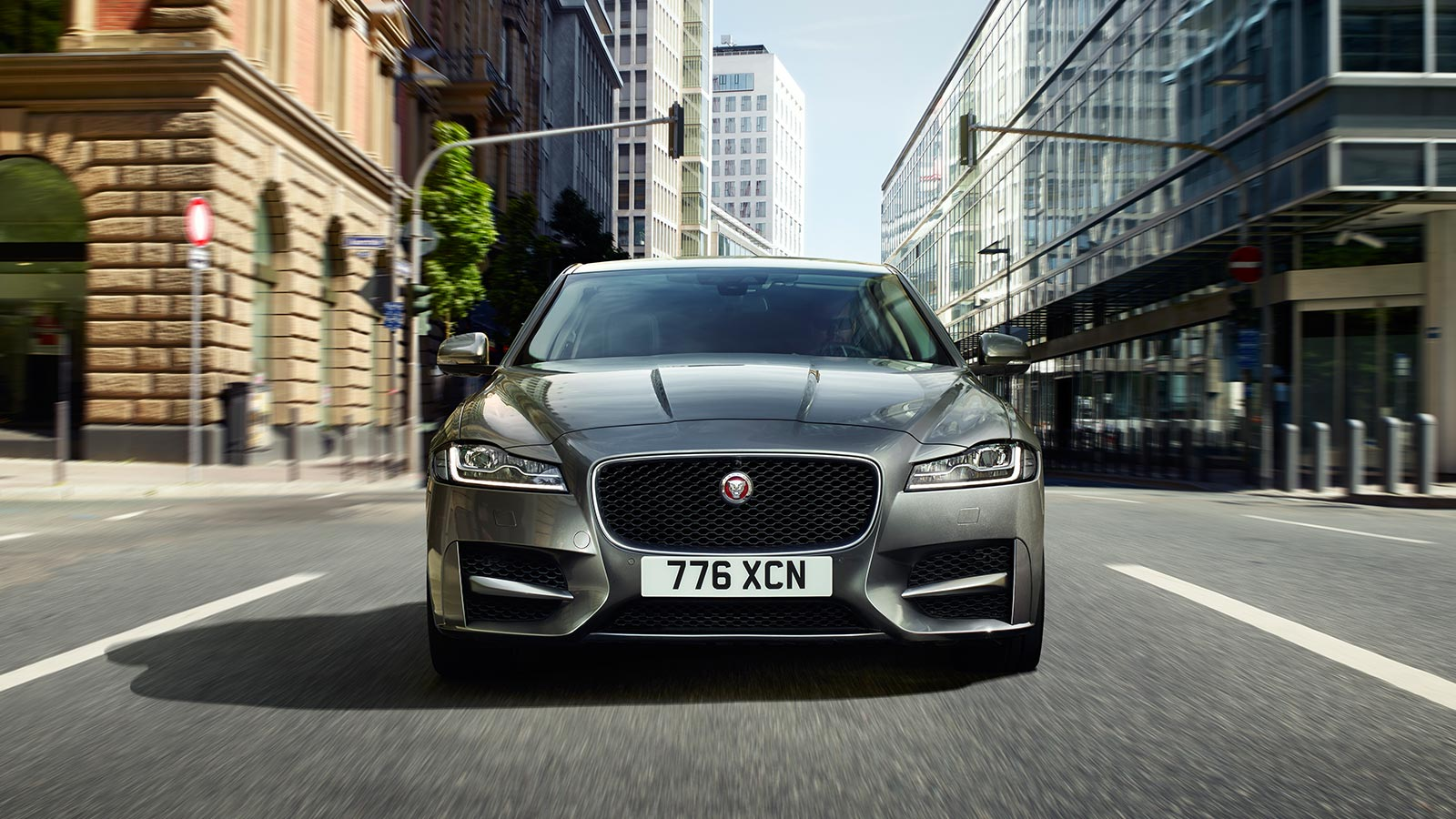 Jaguar XF Driving In City Front View