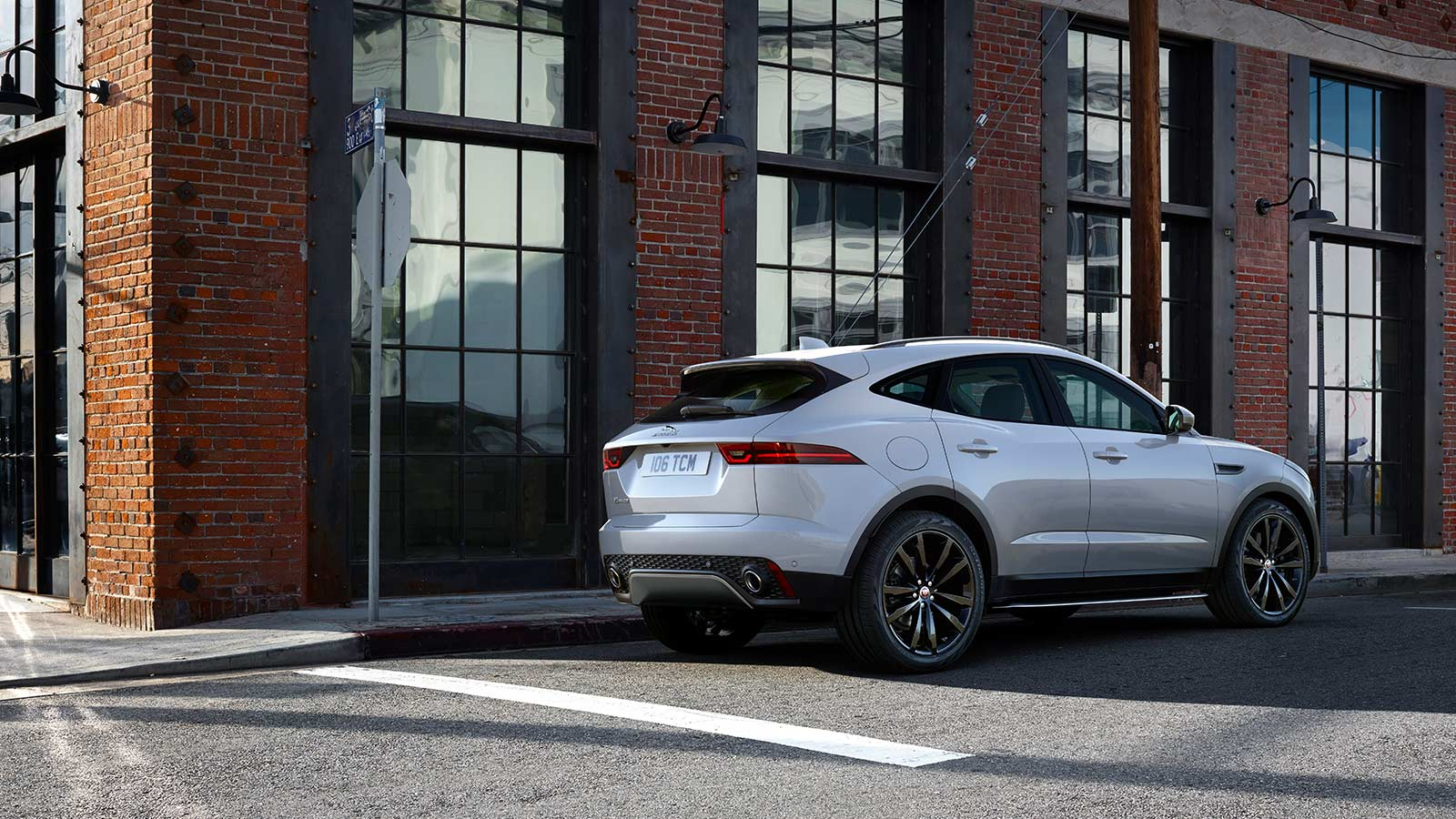 E-PACE S IN BORASCO GREY WITH OPTIONAL FEATURES FITTED PARKED IN CITY STREET.