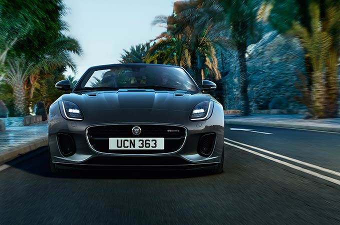 Jaguar F-Type Driving By Palm Trees.