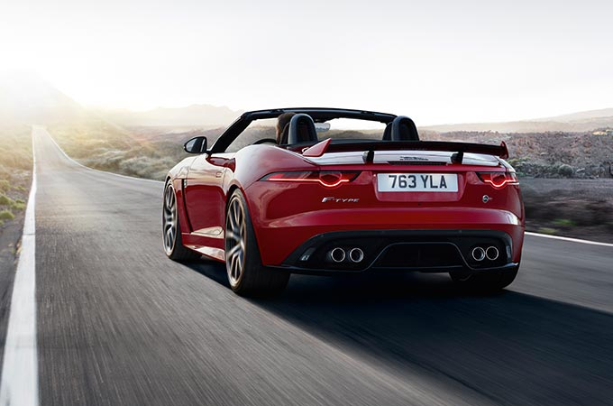 Jaguar F-Type Convertible Driving Along Road.