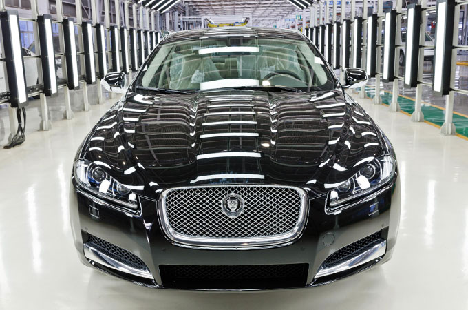Jaguar XJ in black parked in an inspection bay.