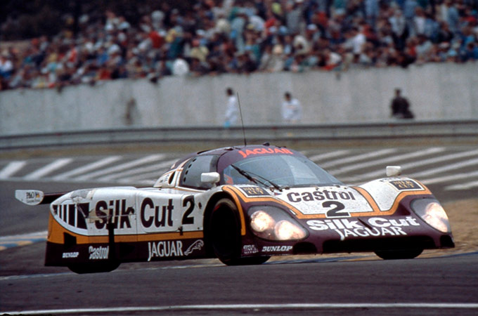 The title-winning Jaguar XJR-9 drives on-track at the 1988 Le Mans.