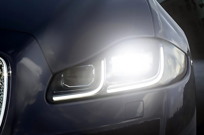Close-up of Jaguar's automatic headlights and intelligent high beam assist.