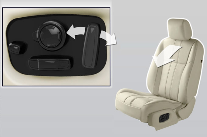 Jaguar car seat, and seat adjustment buttons.