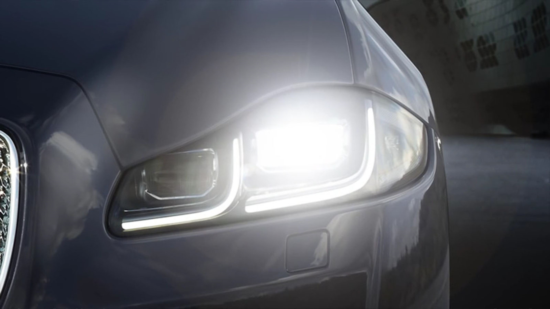 Close-up of Jaguar XJ's automatic headlights and intelligent high beam assist.