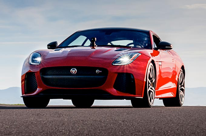Jaguar F-Type driving on tarmac