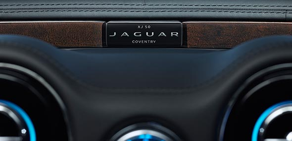 Jaguar XJ50 features an elegant intaglioin in the centre of the dashboard