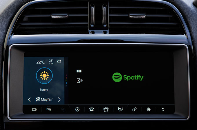 A close up of the touch screen displaying the spotify app logo
