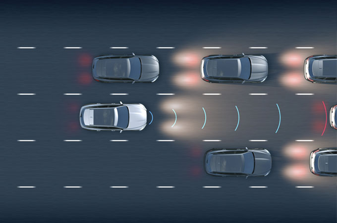 Diagram of the adaptive cruise control slowing the car in response to a car in front getting close.