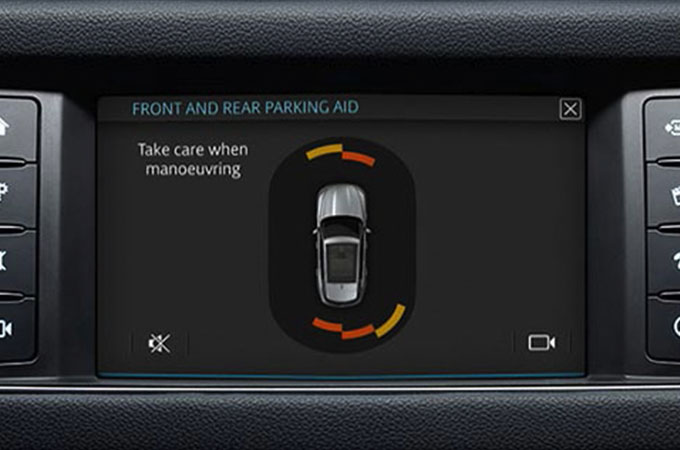 Image of the Touch screen showing the front and rear parking sensors providing display and audio feedback of obstacles.