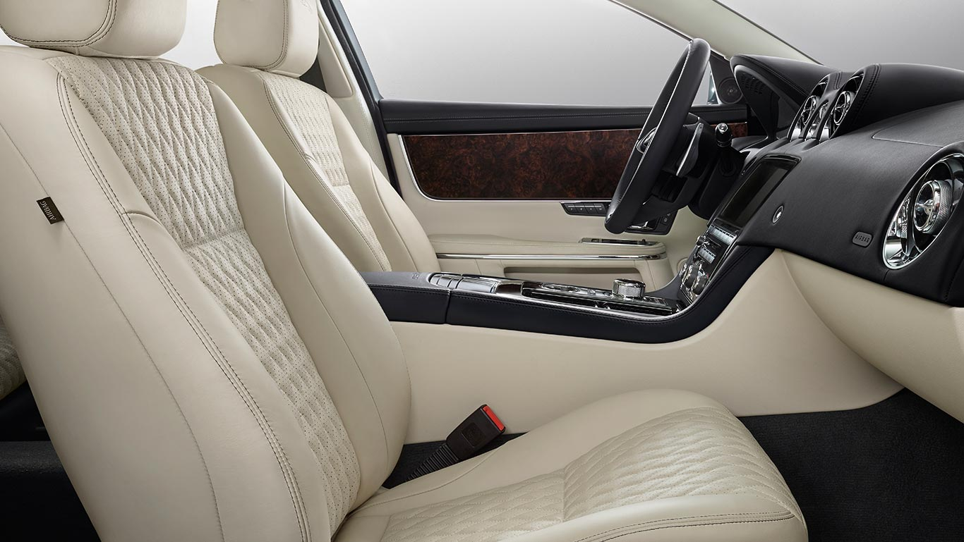 XJ50 Long Wheelbase with Ivory soft grain perforated quilted leather seats with Ebony contrast stitch, Ebony upper fascia, Ivory Morzine headlining, Gloss Shadow Walnut veneer and Ebony carpet with optional features fitted (European model shown)