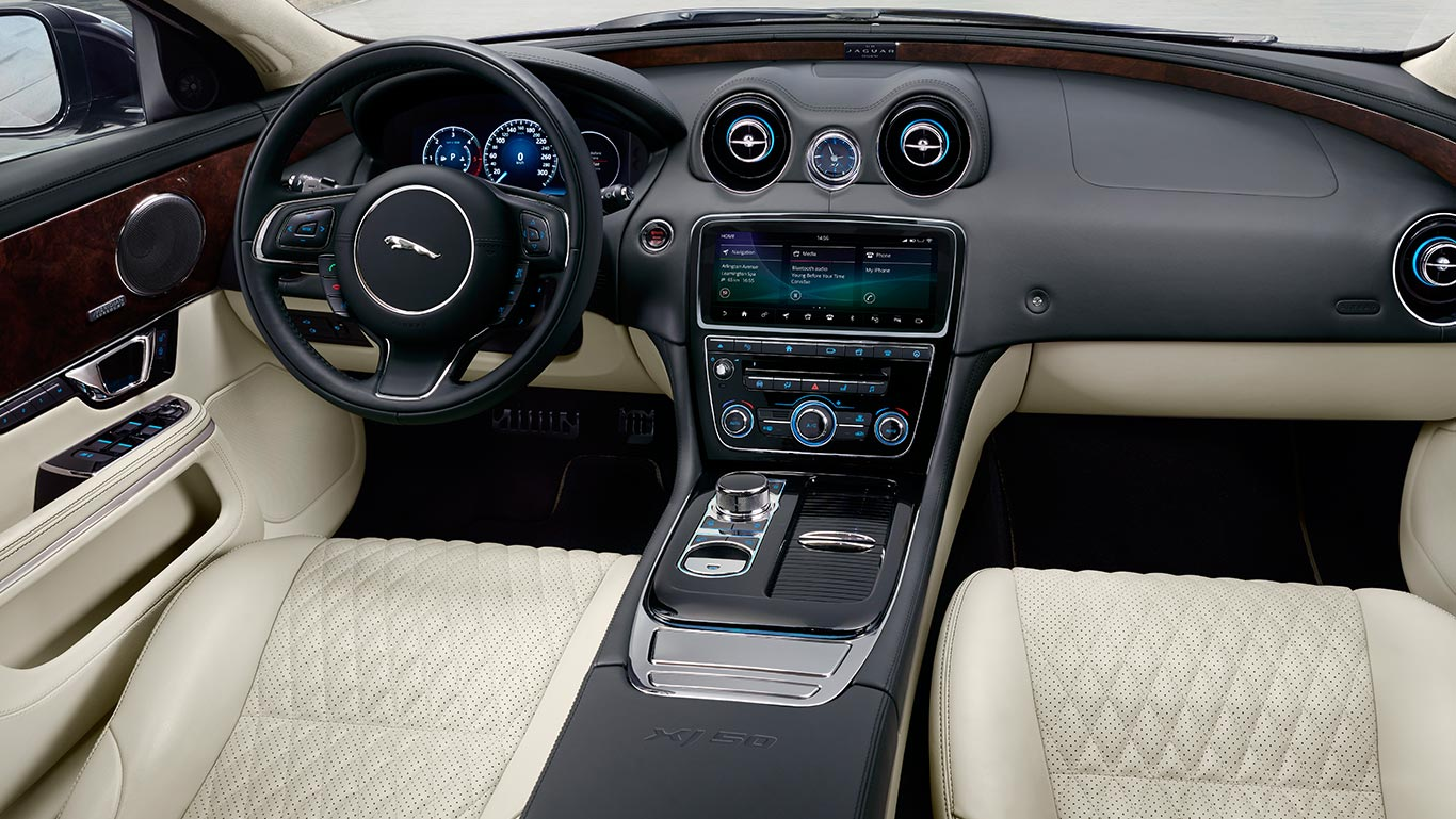 XJ50 Long Wheelbase with Ivory soft grain perforated quilted leather seats with Ebony contrast stitch, Ebony upper fascia, Ivory Morzine headlining, Gloss Shadow Walnut veneer, Ebony carpet and metallic foot pedals with optional features fitted (European model shown)